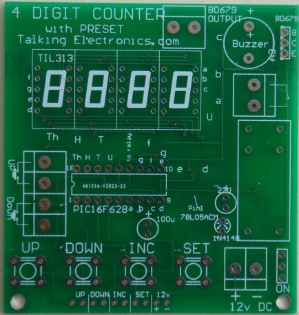 The top output has 12v on the left output and the right  output is connected to the BD679 transistor.  You can place a load on these connections up to 2 amp - the BD679 will carry up to 8 amp if it  has a large heatsink. The letters on the board refer to the display segments and the  surface-mount transistors driving each segment. These have been added to assist with servicing.