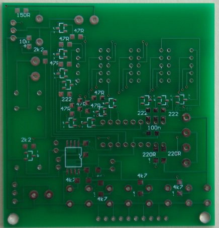 The underside of the board has all the surface-mount components for driving the display at high brightness. We have not relied on the 20mA output of the chip to drive the segments. The 78L05ACM is a surface-mount regulator:  5v, 100mA