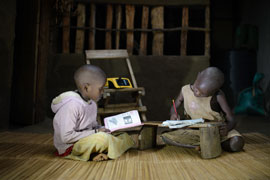 Children-studying-at-night-under-light-from-the-ReadyPay-Power-System