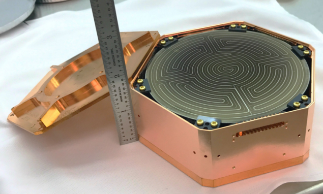 Hockey puck: one of six crystal packs that will comprise a SuperCDMS detector tower (Courtesy: Matt Cherry/SuperCDMS collaboration/SLAC National Accelerator Laboratory)