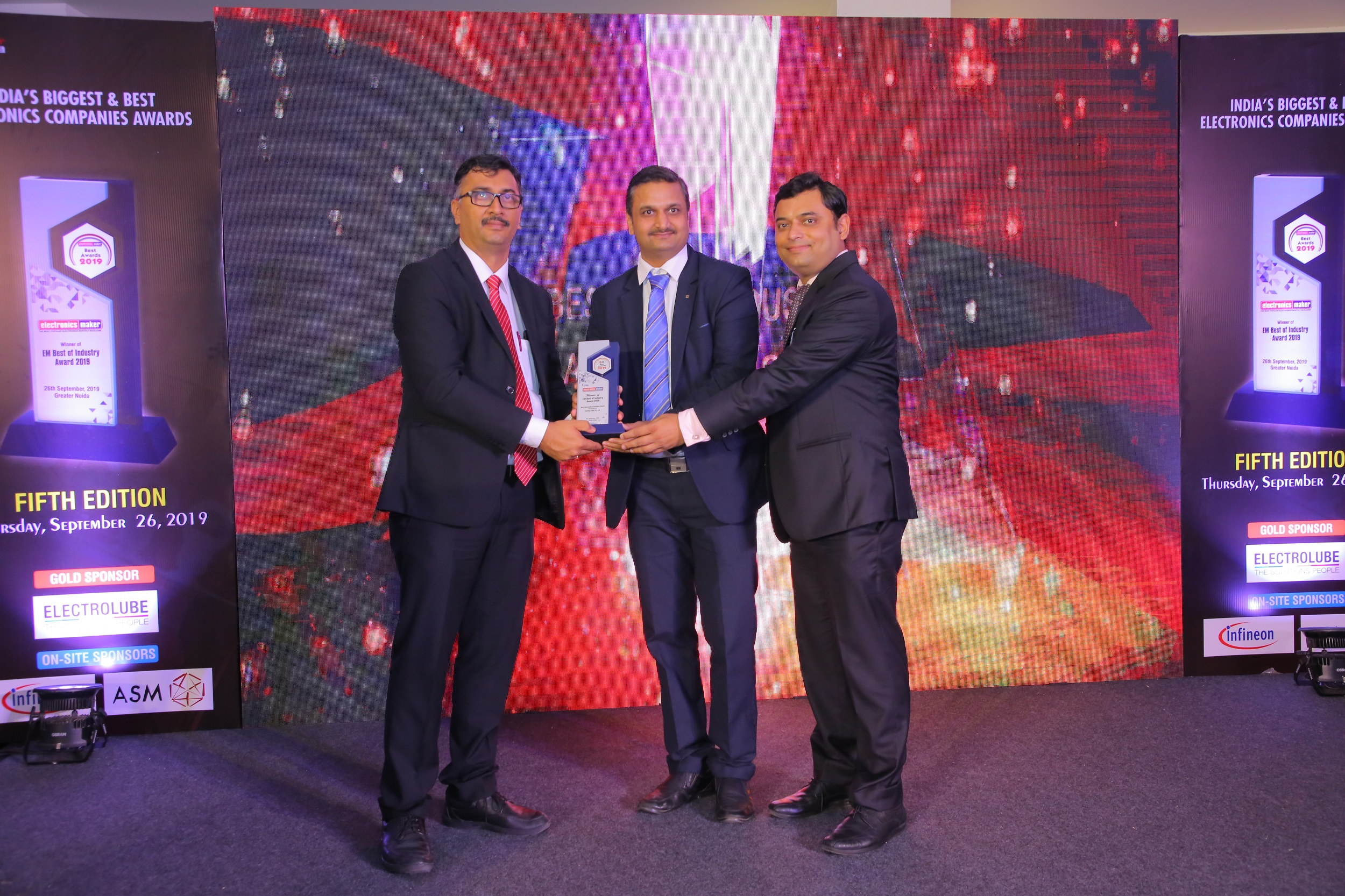 Caption: Mr. Anup Kapadia, Product Manager Device Connectivity HARTING India (middle) along with Mr. Abhishek Bimal, Marcomm Manager HARTING India (right), being awarded the trophy from Mr. Vasanth Kumar, General Manager, India, ASM Assembly Systems.